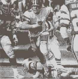 Archie Manning scrambles against the Eagles in 1974