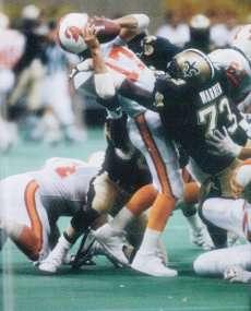 Frank Warren of the 1991 New Orleans Saints sacks Chris Chandler of Tampa Bay.