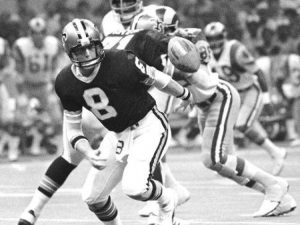 Archie Manning of the Saints fumbling against the Rams