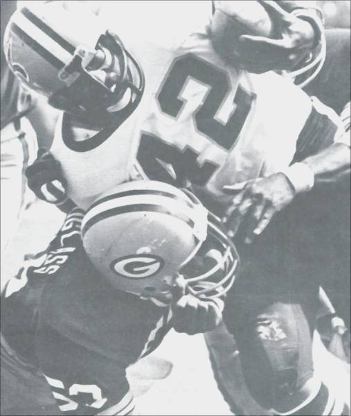 New Orleans Saints Chuck Muncie carries against the Packers