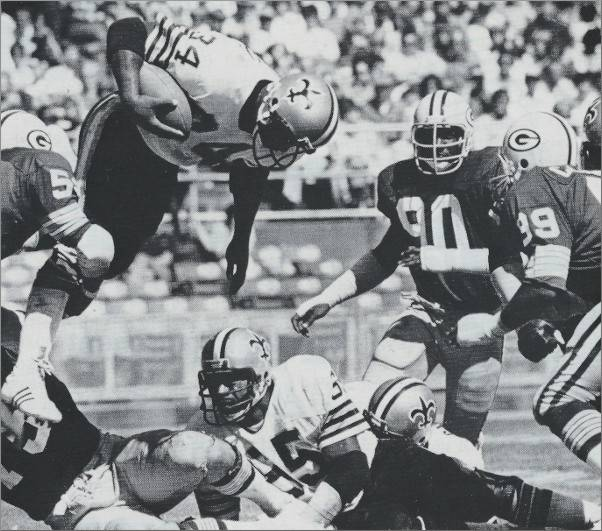 Saints Fullback Tony Galbreath goes over the top against the Packers in 1979.