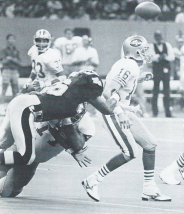 All-Pro Linebacker Pat Swilling strips the ball from 49er quarterback Joe Montana