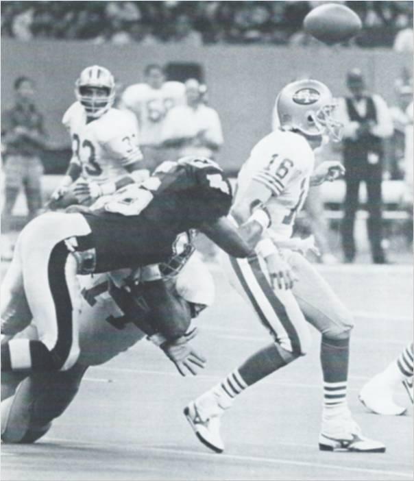 All-Pro Linebacker Pat Swilling strips the ball from 49er quarterback Joe Montana
