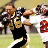 Deuce McAllister loses his helmet in 2003