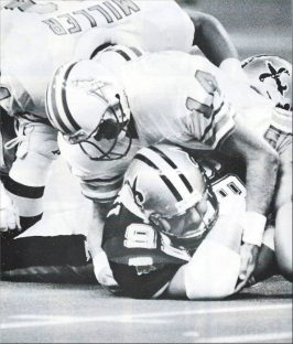 Saints Defensive Lineman Tony Elliott recovers a fumble in 1987 against Houston