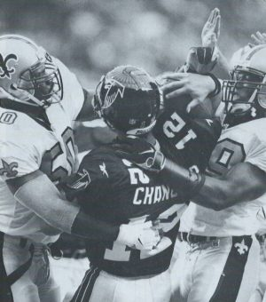 Saints Kevin and Keith Mitchell sack Chris Chandler of the Falcons