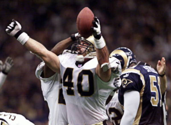 Brian Milne of the New Orleans Saints celebrates fumble recovery against the Rams in 2000 playoffs