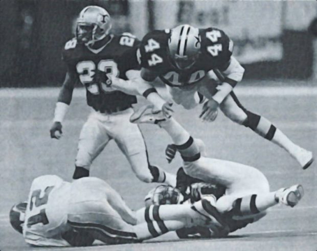 Randal Cunningham is stopped by New Orleans Saints defenders Sam Mills, Dave Waymer and Gene Atkins
