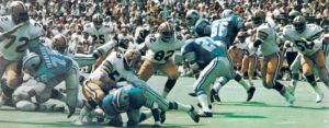 the 1973 New Orleans Saints defense closes in on a Lion runner