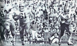 Roy Schmidt and Del Williams lead blocking for Fullback Tony Lorick - Saints Offense in 1968
