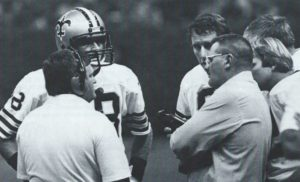 New Orleans Saints Quarterback Dave Wilson confers with Archie Manning and Bum Phillips