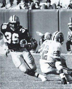 Reuben Mayes carries against the Falcons in 1987