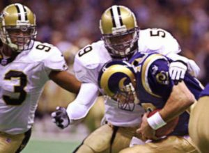 Keith Mitchel and Darren Howard Sack Kurt Warner