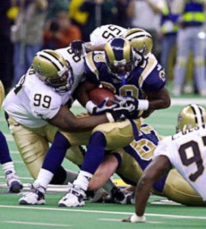 Norman Hand and Mark Fields Stop Marshall Faulk