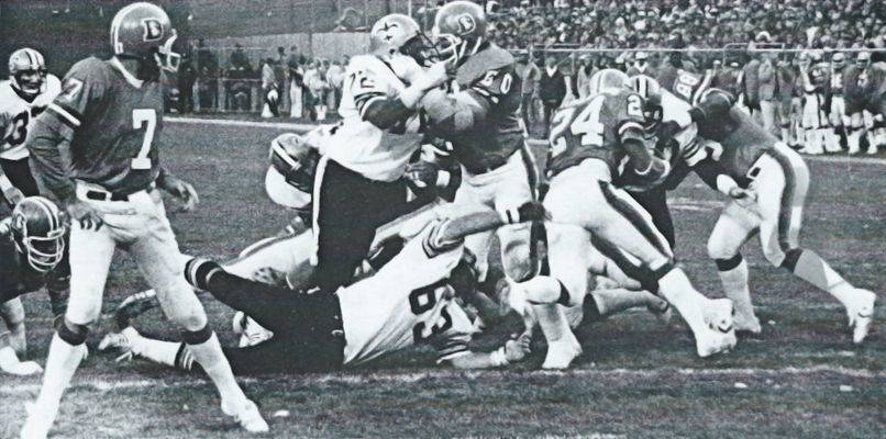 The New Orleans Saints Defense stops Otis Armstrong of the Denver Broncos in 1979