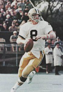 Saints Quarterback Archie Manning rolls out to pass