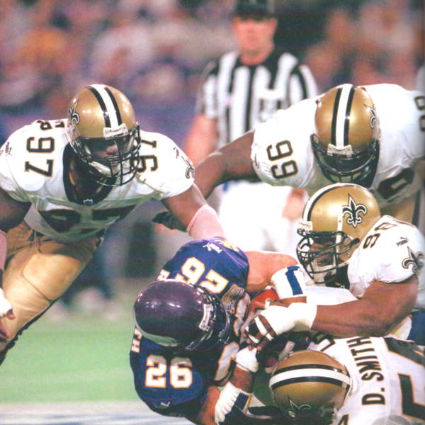La'Roi Glover, Norman Hand,Willie Whitehead and Darrin Smith stop Vikings runner Robert Smith in the 2000 Playoffs