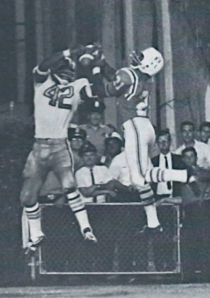 Saints Receiver John Gilliam battles for the ball against a Boston Patriots defender.